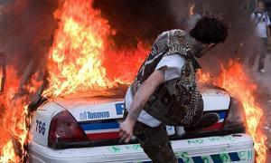 A-protester-kicks-a-burni-006.jpg